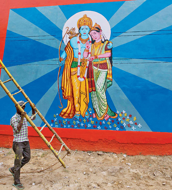 A worker on Sunday paints a street wall in Ayodhya as part of preparations for the August 5 ceremony at Ram temple.