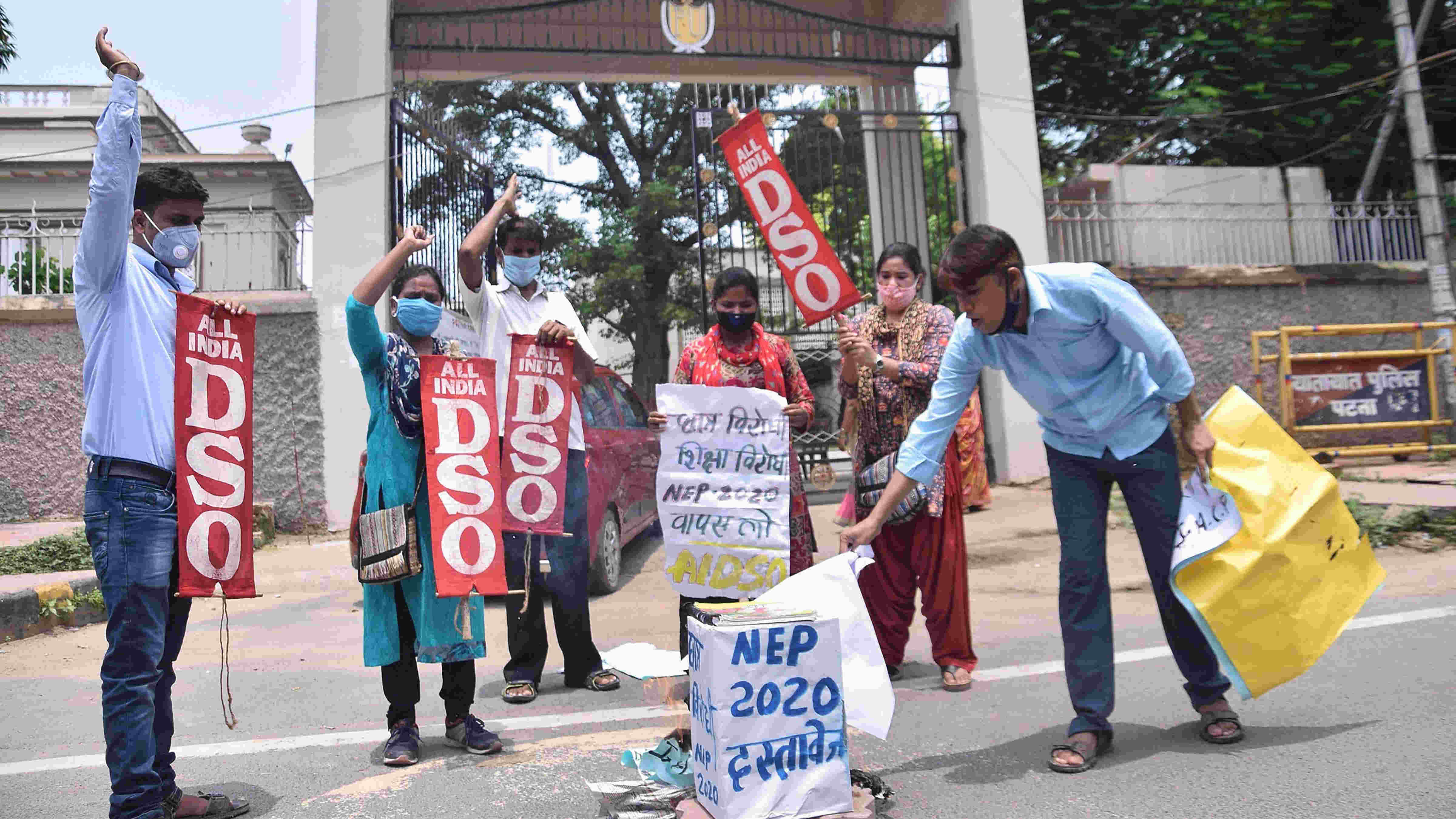AIDSO activists burn copies of the new National Education Policy 2020 outside Patna University, in Patna, Friday, July 31, 2020.