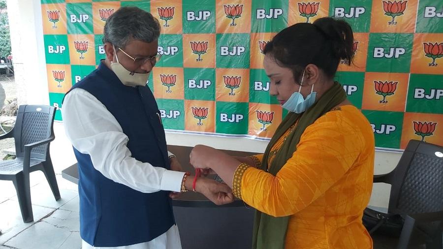 Yoga teacher Rafia Naaz ties a rakhi on BJP leader Babulal Marandi in Ranchi on Monday