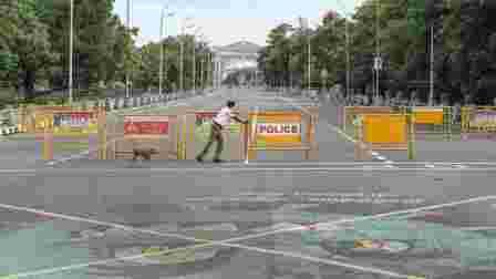 Traffic police personnel block a road during an intensified lockdown imposed as a preventive measure against the spread of coronavirus disease, in Chennai, Sunday, Aug 2, 2020.