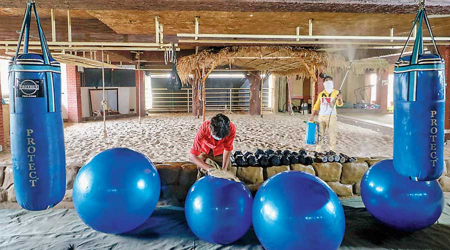 Workers clean a gym and yoga centre in Ahmedabad  last week.