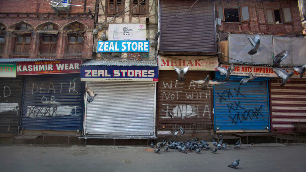 Pigeons fly at a deserted market area during lockdown to stop the spread of the coronavirus in Srinagar, Kashmir, July 22, 2020