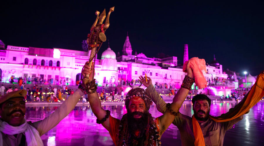 Holy men shout slogans in Ayodhya on Tuesday