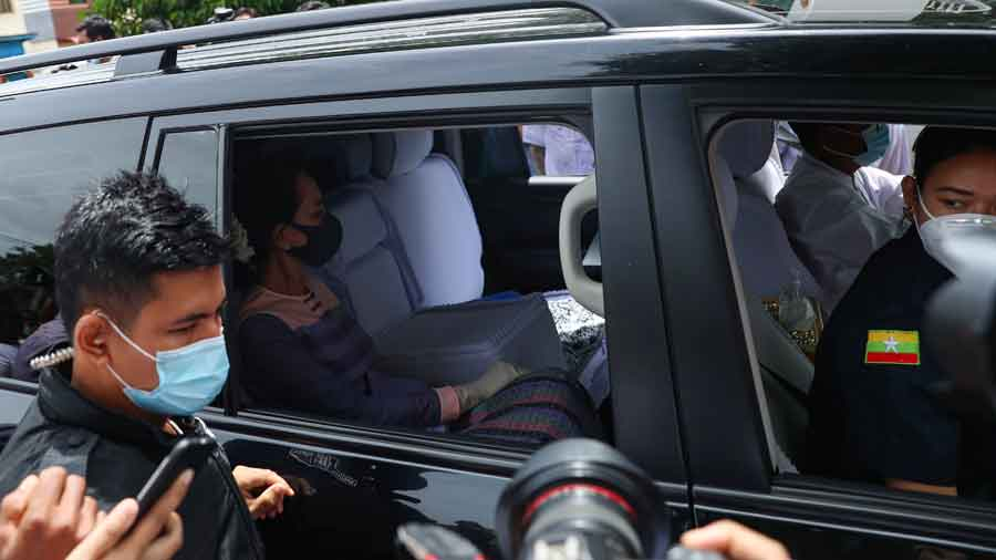 Aung San Suu Kyi, arrives at the district office of the Election Commission to file her certificate of candidacy on Tuesday
