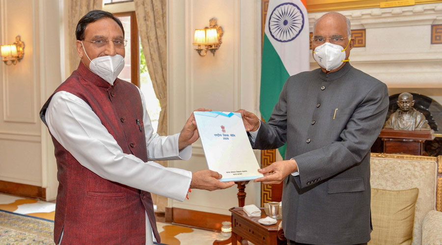 Union human resource development minister Ramesh Pokhriyal presents to President Ram Nath Kovind a copy of National Education Policy 2020 in New Delhi on Tuesday.