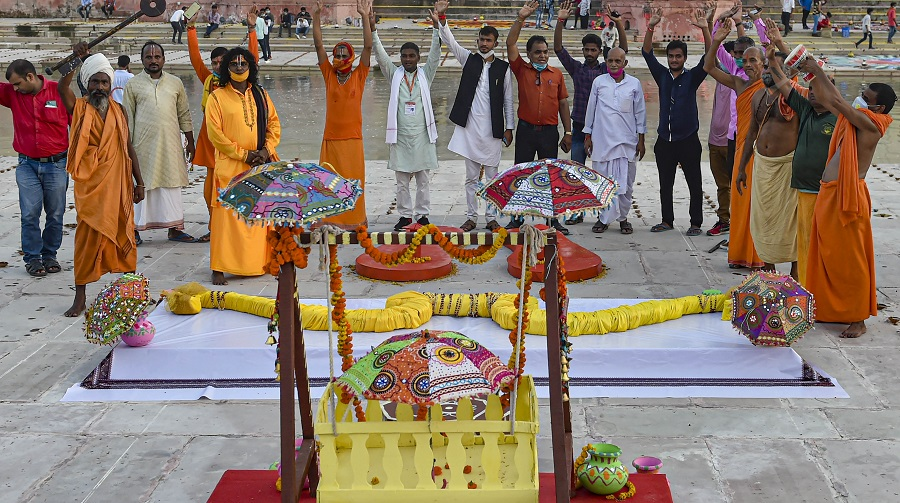 A large Khadau (wooden slippers), bow and arrow, and palanquin put on display at Naya Ghat in Ayodhya on Tuesday