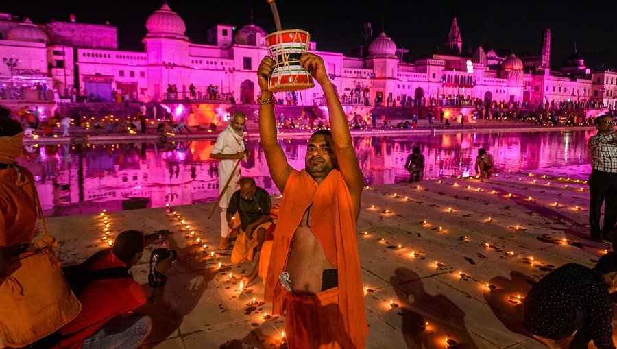 Hindu devotees celebrate Deepotsav at Ramghat on the eve of Bhoomi Pujan of the Ram Temple, in Ayodhya on Tuesday