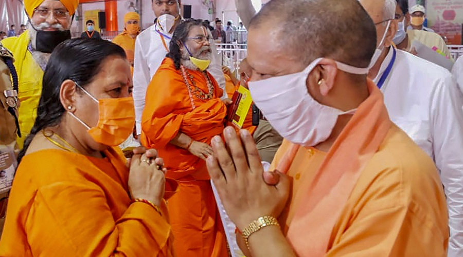 Uttar Pradesh Chief Minister Yogi Adityanath being greeted by BJP leader Uma Bharti in Ayodhya on Wednesday