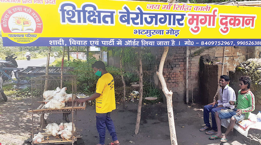 Kismat Bhuiyan (in yellow T-shirt) operates his new chicken shop in Dhanbad on Wednesday.