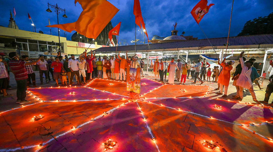 Gayawal Pandas community members light earthen lamps to celebrate the ground-breaking ceremony of the Ram Temple in Ayodhya on Wednesday.