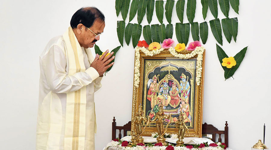 Vice-President Venkaiah Naidu offers prayers at his residence in New Delhi on Wednesday.