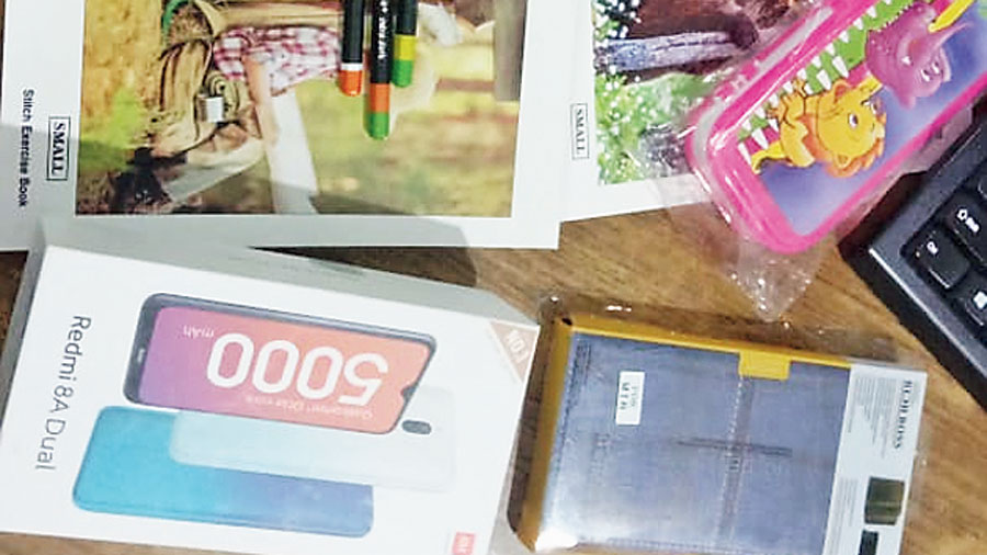 The kit for children that includes stationery and a phone