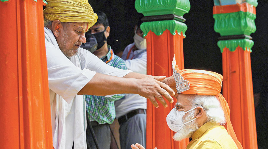Prime Minister Narendra Modi being felicitated by a priest during his visit to Hanuman Garhi in Ayodhya on Wednesday.