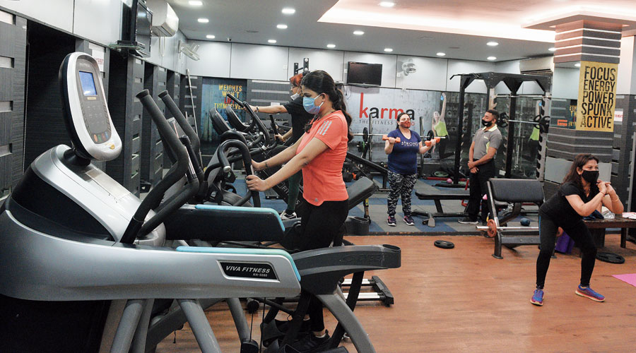 People work out at a gym in Mudiali on Thursday. Gyms reopened on Thursday after remaining closed for over four months as a precaution against Covid-19.