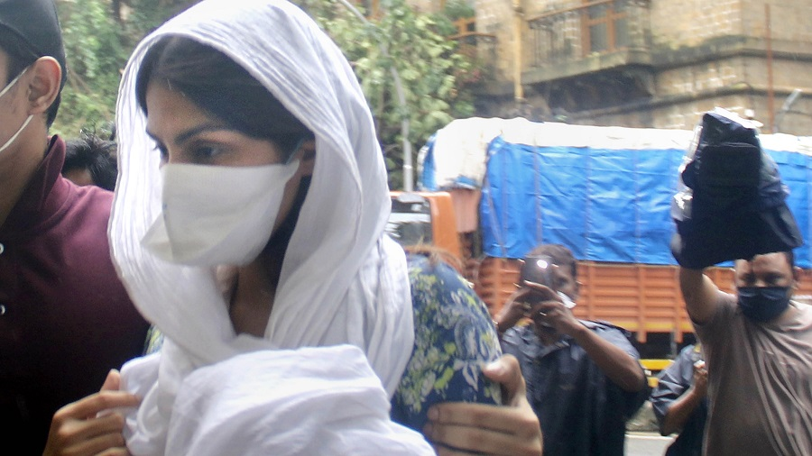 Bollywood actress Rhea Chakraborty arrives at Enforcement Directorate office for questioning in connection with a money laundering case, in Mumbai on Friday