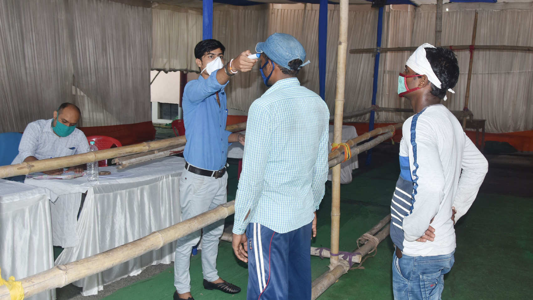 Visitors to Patliputra Medical College and Hospital undergo thermal screening going in Dhanbad on Friday.