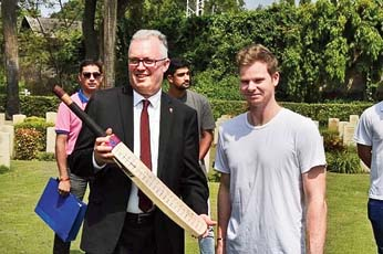 Ford with cricket star Steve Smith on Anzac Day at the Bhowanipore cemetery