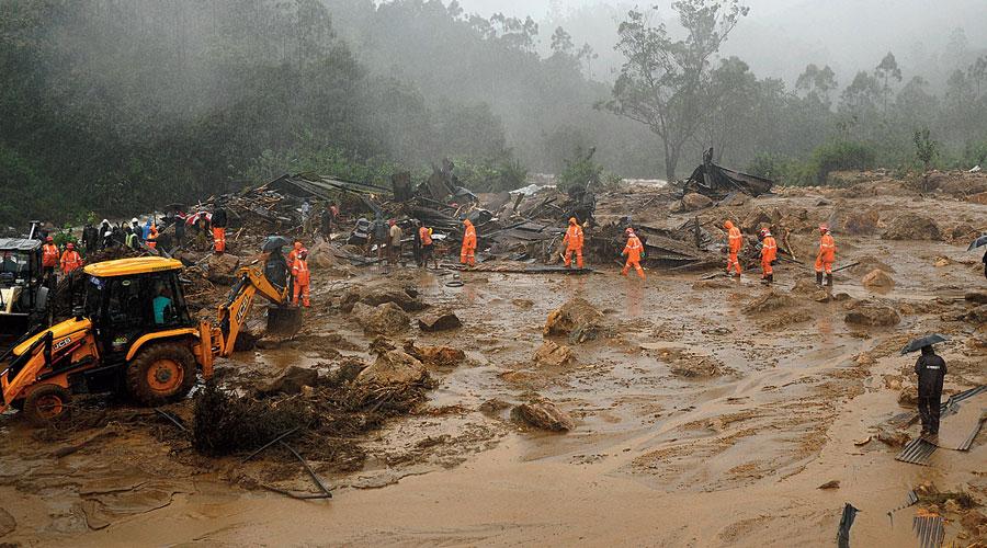 Rescuers look for survivors.