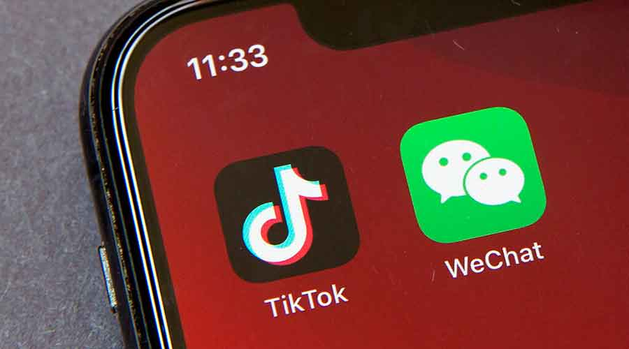 Icons for the smartphone apps TikTok and WeChat are seen on a smartphone screen in Beijing, Friday, August 7, 2020.