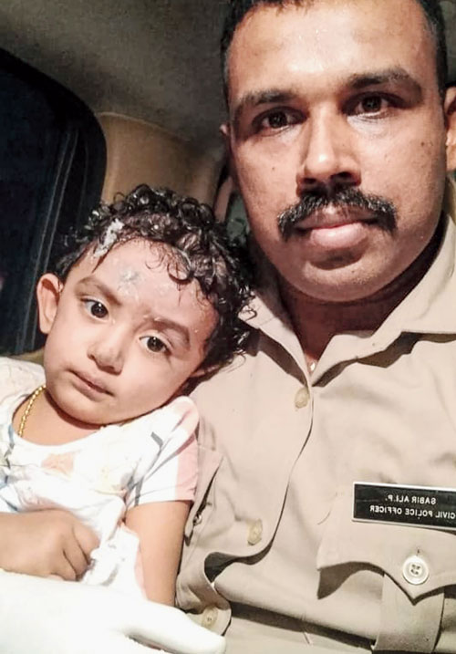 A child, who was on board the Air India Express flight, after being rescued.