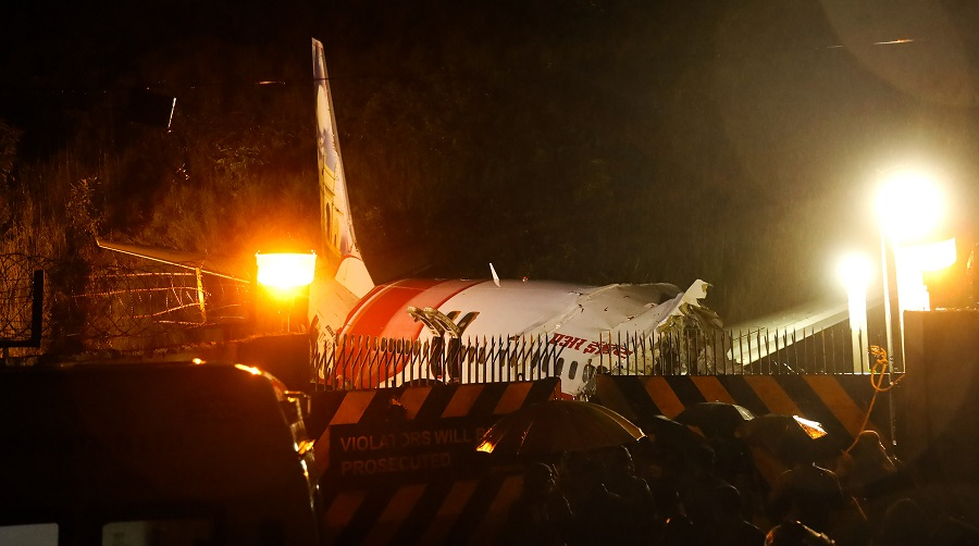 Mangled remains of an Air India Express flight en route from Dubai after it skidded off the runway while landing, in Kozhikode on Friday