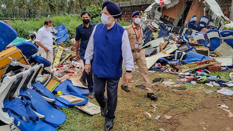 Union Civil Aviation Minister Hardeep Singh Puri inspects the crash site of the Air India Express flight