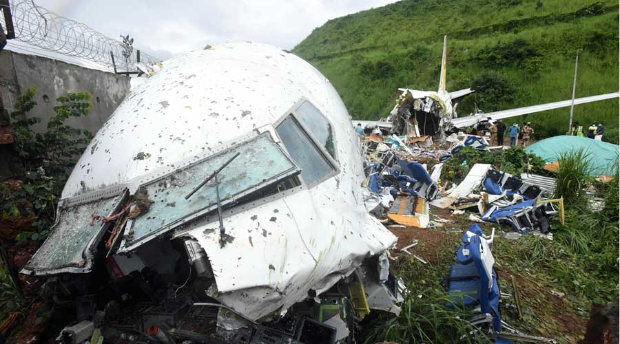 The wreckage of the Air India Express jet is seen at the foot of the tabletop runway in north Kerala.