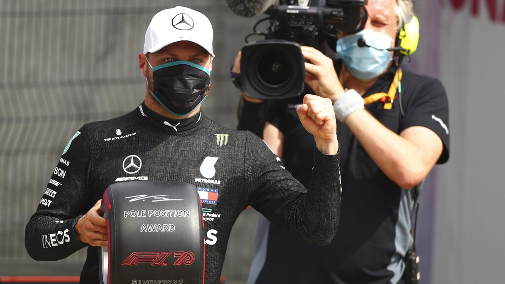 Mercedes driver Valtteri Bottas of Finland jubilates after setting the fastest time during the qualifying session at the 70th Anniversary Formula One Grand Prix at the Silverstone circuit, England, on Saturday.