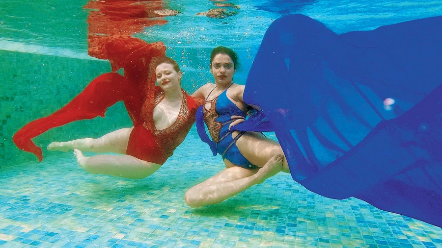 Subhamita wore a blue lycra monokini with embroidered and sequinned yoke with tape detailing, while Solveig was wearing a red monokini with embroidered and sequinned yoke. The blue and red georgette flowing in the water gave it an ethereal feel.