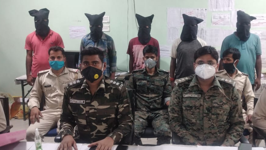 Police officials with arrested five extremists in Hazaribagh on Sunday.
