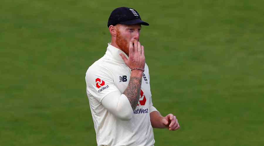 Ben Stokes gestures during the fourth day of the first cricket Test match between England and Pakistan at Old Trafford in Manchester, England, Saturday, August 8, 2020.