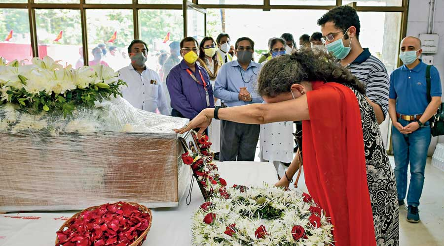 Air India Express pilot Captain Deepak Sathe's wife Sushma Sathe and their younger son Dhananjay Sathe pay tribute to him at Mumbai airport on Sunday. Captain Sathe died during a crash at the Calicut International Airport in north Kerala on Friday night.