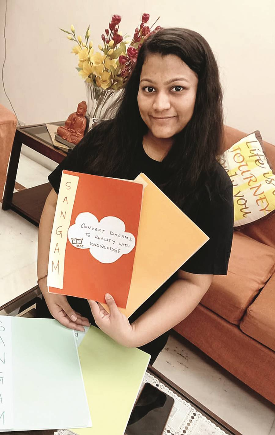 Sukriti with the handmade notebooks