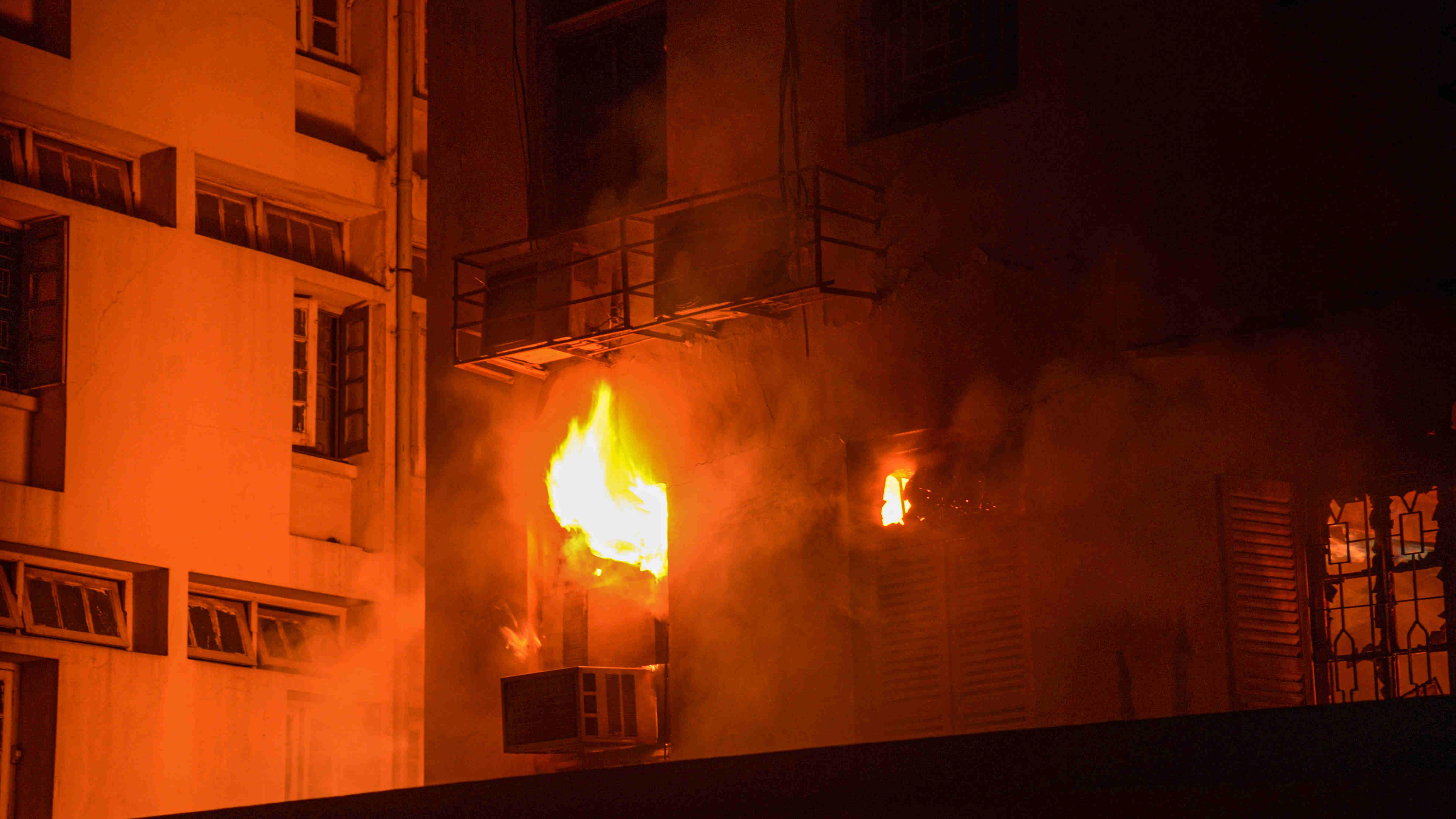 Flames rise from a building after a massive fire broke out at a multistory building at Pollock Street, Calcutta, Monday, Aug. 10, 2020.