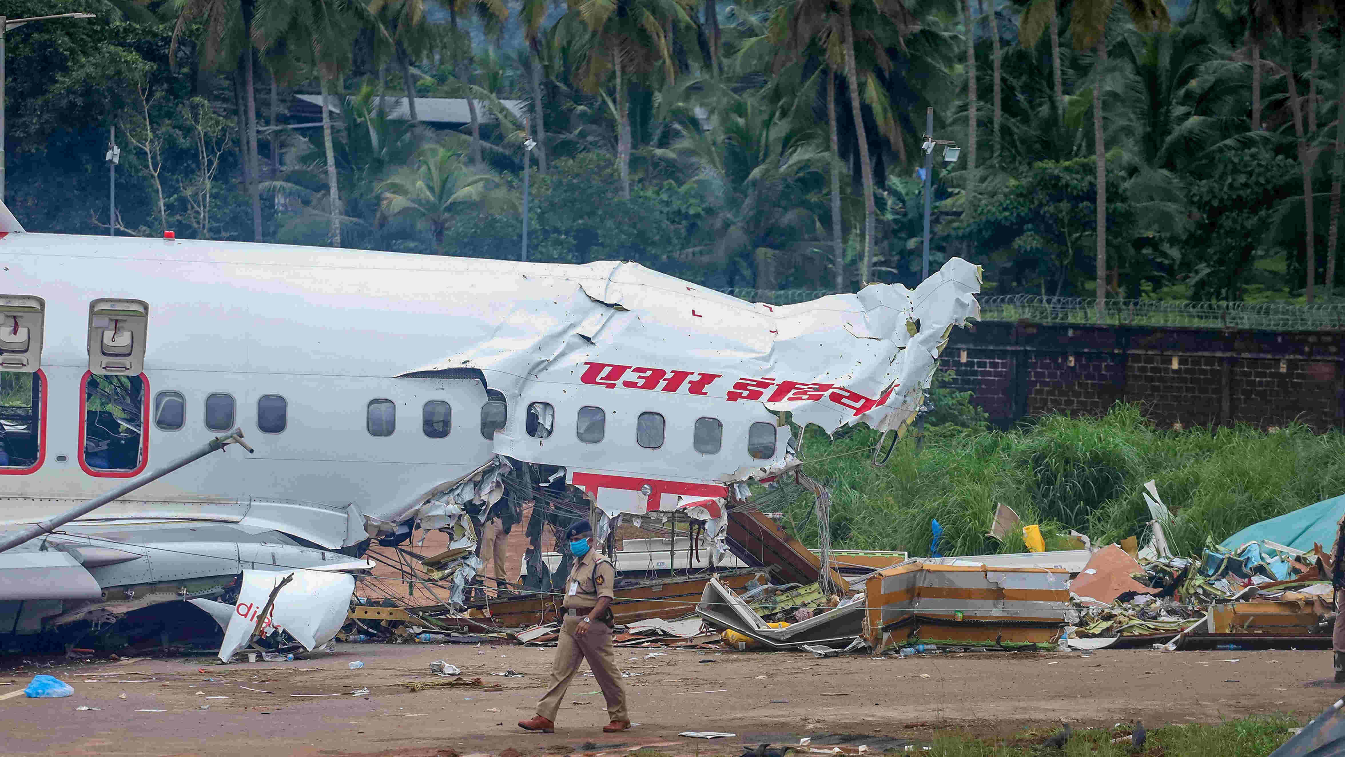 Mangled remains of an Air India Express flight, en route from Dubai, after it skidded off the runway while landing on Friday night, at Karippur in Kozhikode.