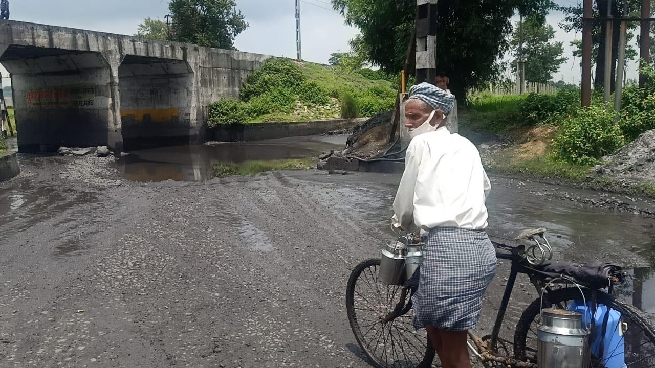 A villager walks on the Kusumbha Main road in Hazaribagh on Monday.
