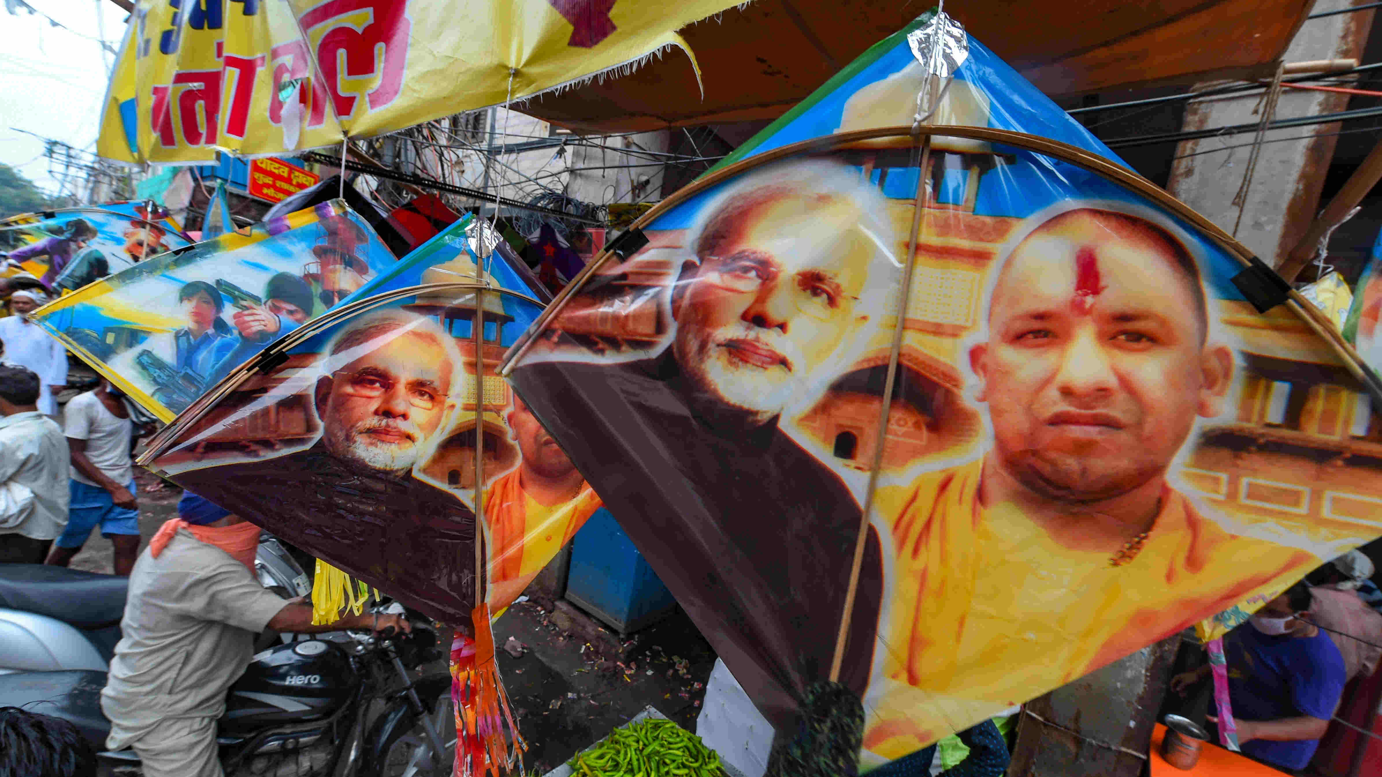 Kites with images of Modi and Yogi Adityanath displayed outside a shop ahead of Independence Day, New Delhi, Sunday, Aug. 9, 2020.