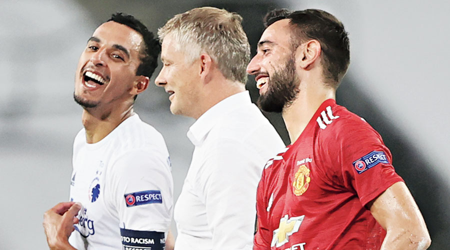 Manchester United manager Ole Gunnar Solskjaer flanked by FC Copenhagen's Zeca (left) and United scorer Bruno Fernandes after their Europa League match on Tuesday.