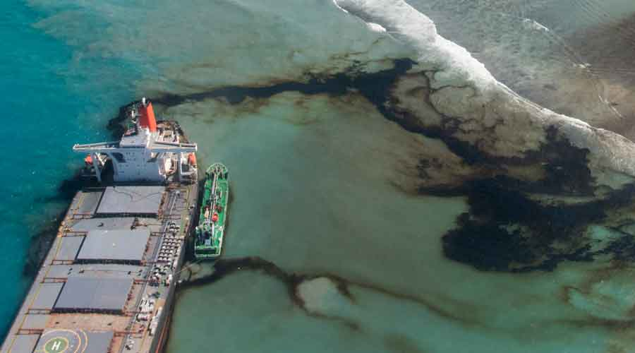 This photo provided by the French Army shows oil leaking from the MV Wakashio, a bulk carrier ship that ran aground off the southeast coast of Mauritius, on Tuesday