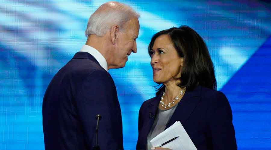 Democratic presidential candidate former Vice President Joe Biden, left, and then-candidate Sen. Kamala Harris, D-Calif. shake hands after a Democratic presidential primary debate hosted by ABC at Texas Southern University in Houston