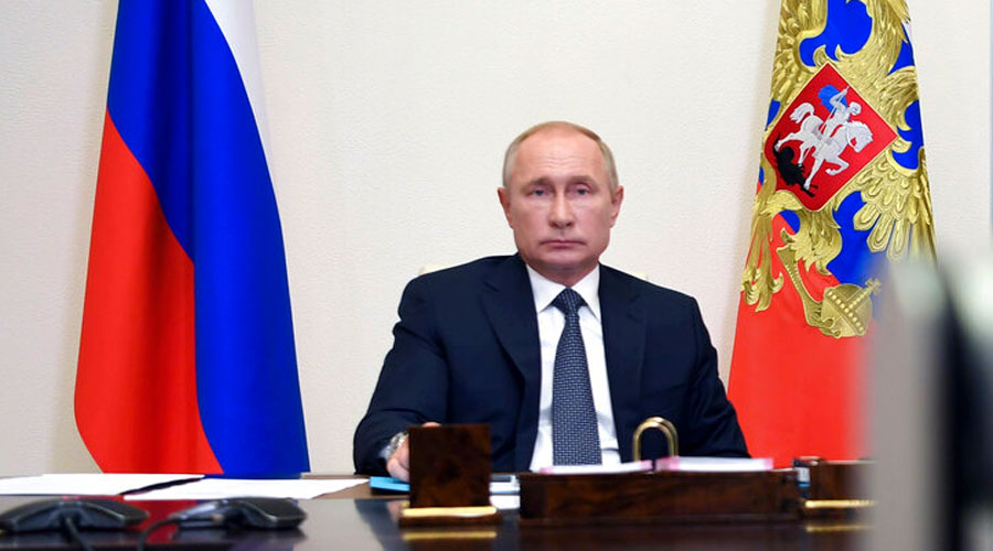 Vladimir Putin attends a cabinet meeting at the Novo-Ogaryovo residence outside Moscow, Russia, on Tuesday.