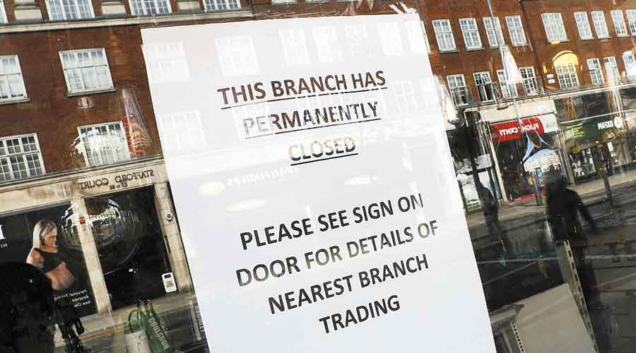 A sign on the window of a closed shop in Kensington, London, on Wednesday