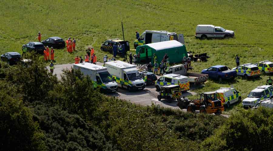 Emergency services attend the scene of a derailed train in Stonehaven, Scotland, on Wednesday