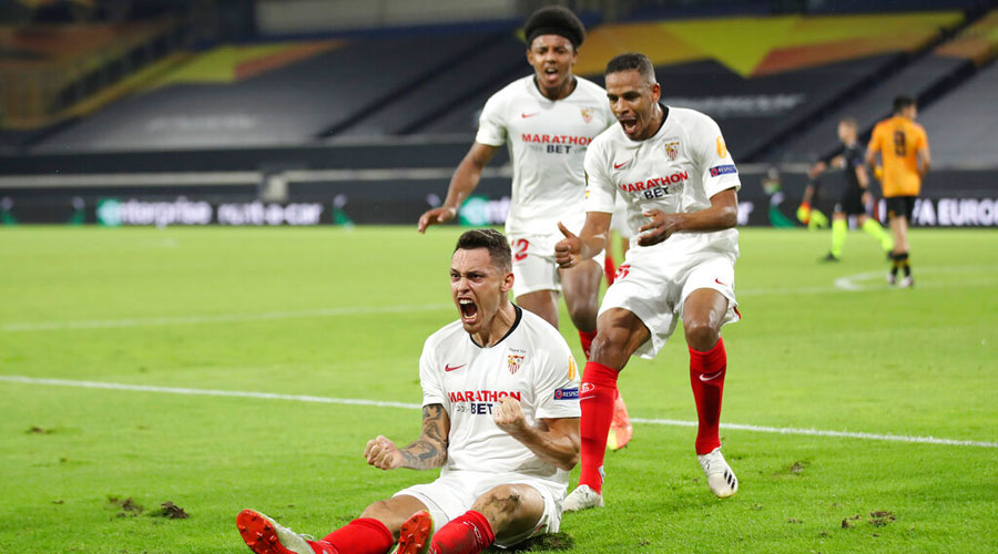 Lucas Ocampos, bottom left, celebrates with his teammate after scoring his side's opening goal during the Europa League quarterfinal in Duisburg, Germany, on Tuesday.