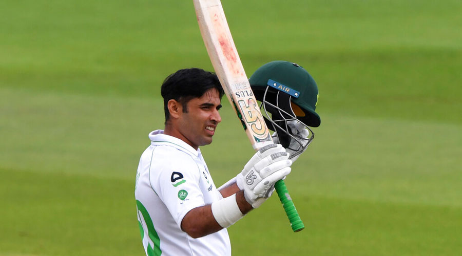 Abid Ali raises his bat to celebrate scoring fifty runs during the first day of the second cricket Test match between England and Pakistan in Southampton on Thursday.