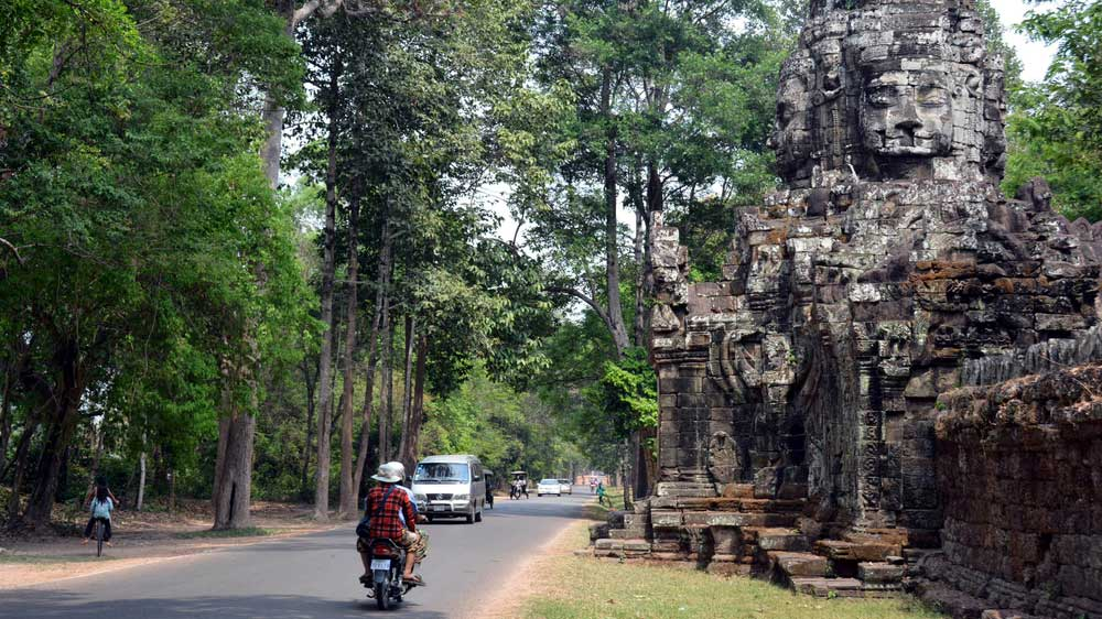 Tourists explore the sprawling religious complex of Angkor Wat.