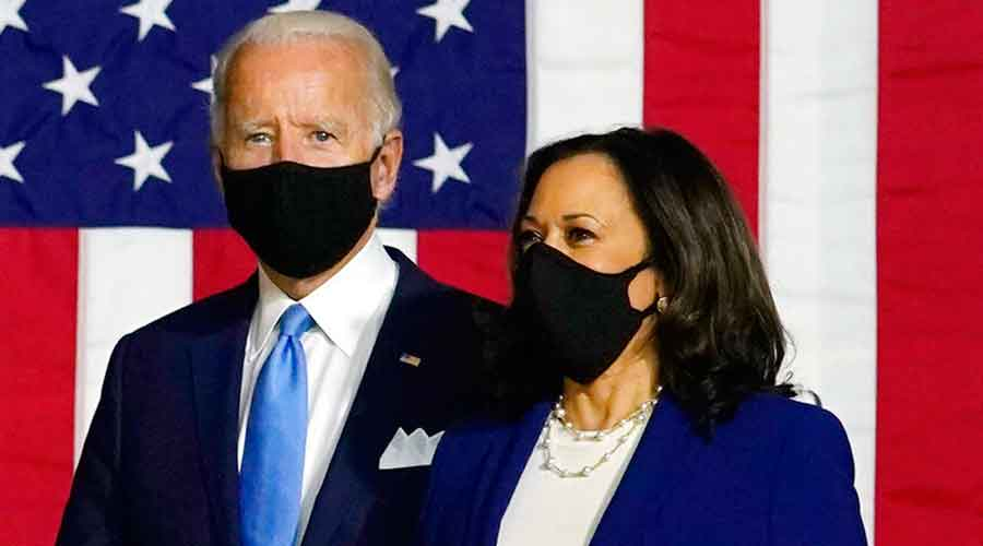 Democratic presidential candidate former Vice President Joe Biden and his running mate Senator Kamala Harris arrive to speak at a news conference at Alexis Dupont High School in Wilmington, Wednesday, August 12, 2020.