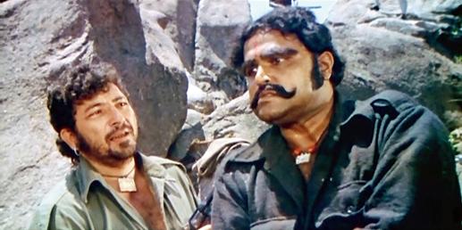 Amjad Khan as Gabbar Singh, with Viju Khote who played Kaalia