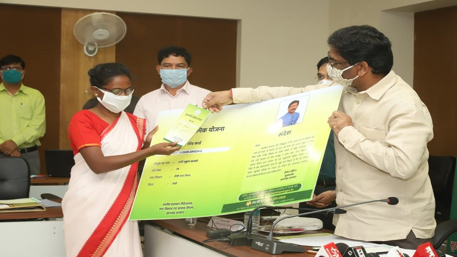 Chief minister Hemant Soren hands over a job card to a beneficiary of a new job scheme he launched in Ranchi on Friday