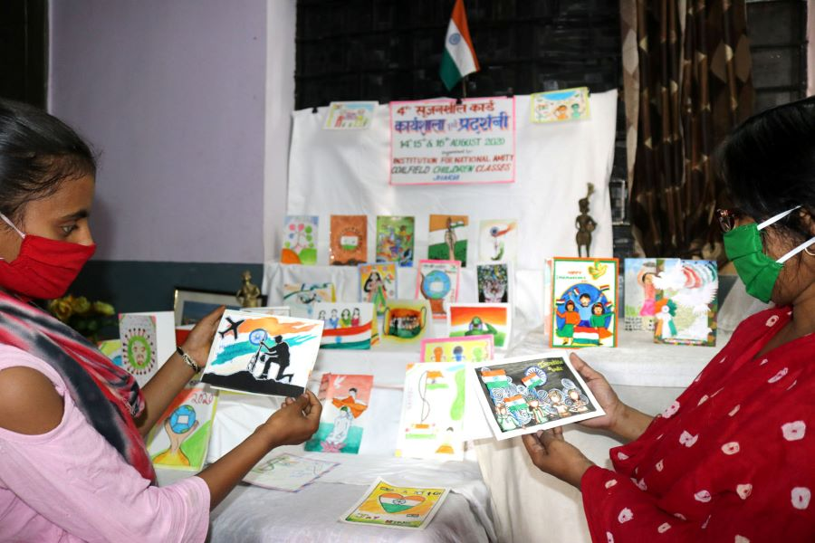 Students of Institution for National Amity, Coalfield Children Classes, Jharia showing their patriotic cards during the workshop-cum-exhibition at their institute in Jharia, Dhanbad on Friday
